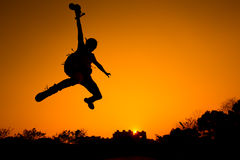 Silhouette of Man jumping Stock Image