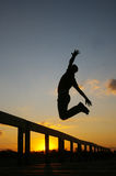 Silhouette of a man jumping Stock Images
