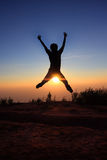 Silhouette man  jumping over the sun. Picture of silhouette man  jumping over the sun Royalty Free Stock Photos