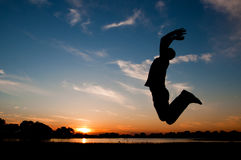 Silhouette of a man jumping in the sunset Stock Photography