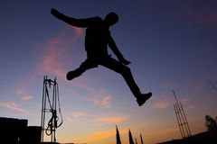 Silhouette of man jumping on sunset background Royalty Free Stock Image