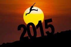 Silhouette of man jumps above number 2015 Royalty Free Stock Photo