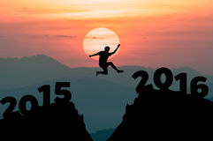 Silhouette man jumps to the New Year 2016 Stock Images