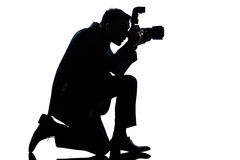 Silhouette man kneeling photographer Stock Photography