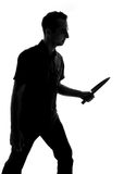Silhouette of a man with knife Royalty Free Stock Photography