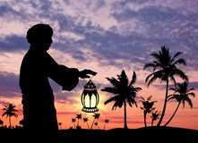 Silhouette of  man with  lamp in  hand Royalty Free Stock Photography