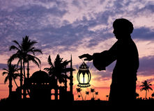 Silhouette of  man with  lamp in  hand Royalty Free Stock Photos