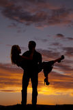 Silhouette man lifting woman look at each other Royalty Free Stock Photos