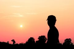 Silhouette of a man. Look at the sunset Royalty Free Stock Images