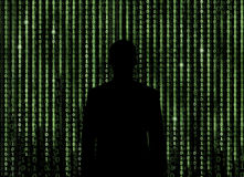 Silhouette of man looking through the matrix background Royalty Free Stock Images