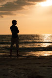 Silhouette Man Looking Out at Beach During Sunset Royalty Free Stock Photos