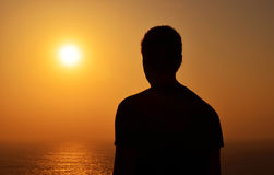 Silhouette of a man looking at algarve sunset Royalty Free Stock Image