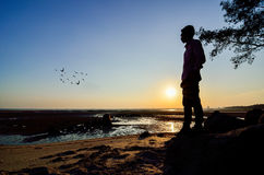 Silhouette of Man looking to the sun Royalty Free Stock Images