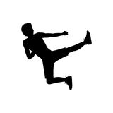 Silhouette man martial arts flying kick. Vector illustration Royalty Free Stock Photo