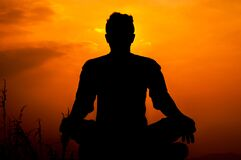 Silhouette of Man meditating outdoor in solitude. - Simple Pleasures in life