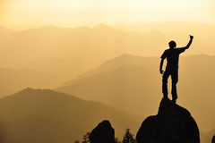 Silhouette of man in mountain. Royalty Free Stock Images