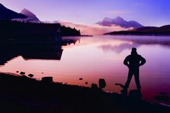 Silhouette Of A Man At A Mountain Lake Stock Photography