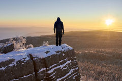 Silhouette of man on the mountain at sunrise. Royalty Free Stock Photography