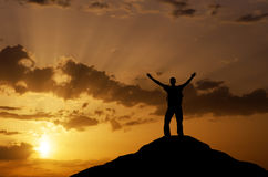 Silhouette of a man on a mountain top. Stock Image