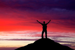 Silhouette of a man on a mountain top. Royalty Free Stock Image