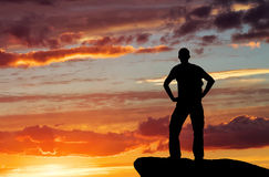 Silhouette of a man on a mountain top Stock Photos