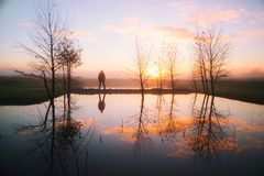 Silhouette of Man Near Body of Water during Sunset Royalty Free Stock Photos
