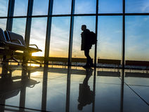 Silhouette of man near window in airport Royalty Free Stock Image