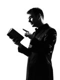 Silhouette  man with note pad Stock Image