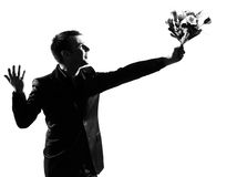 Silhouette  man offering flowers Royalty Free Stock Images