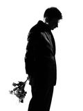 Silhouette  man offering flowers. Silhouette caucasian business man offering flowers expressing behavior full length on studio isolated white background Royalty Free Stock Photography