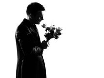Silhouette  man offering flowers Stock Photos
