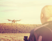 Silhouette of a man operating a drone with remote control for vi royalty free stock images