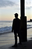 Silhouette of man overlooking ocean Stock Photography