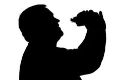Silhouette of a man with overweight eating hamburger Royalty Free Stock Photos