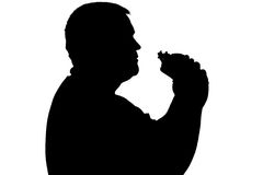 Silhouette of a man with overweight eating hamburger Stock Images