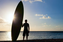Silhouette of a man with paddle board Royalty Free Stock Photo
