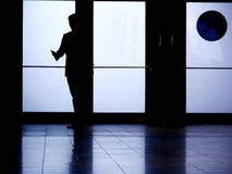Silhouette man phoning Royalty Free Stock Images
