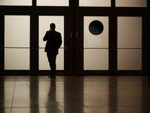 Silhouette man phoning Stock Image