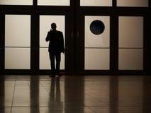 Silhouette man phoning Stock Photo