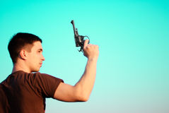 Silhouette of man with pistol Royalty Free Stock Photo