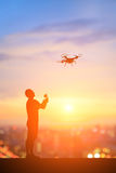 Silhouette of man. Play drone with sunset Stock Photos