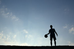 Silhouette of man playin basketball Stock Photo