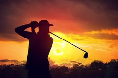 Silhouette of man playing golf at sunset Royalty Free Stock Photo