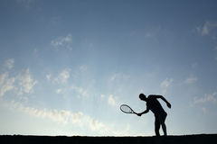 Silhouette of man playing tennis Royalty Free Stock Photos