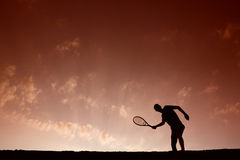 Silhouette of man playing tennis Royalty Free Stock Images
