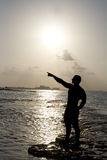 Silhouette of Man Pointing Royalty Free Stock Photography