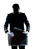 Silhouette man portrait fired carrying heavy box Royalty Free Stock Photography