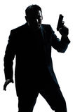 Silhouette man portrait with gun Royalty Free Stock Photo