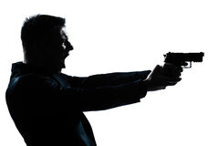 Silhouette man portrait with gun Stock Photo