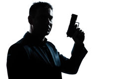 Silhouette man portrait with gun Stock Photo